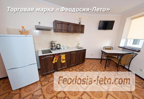 Гостиница в г. Феодосия в Крыму на улице Семашко, номера с кухней - фотография № 18