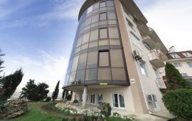 внешний вид здания, где расположен гостевой дом в Феодосии